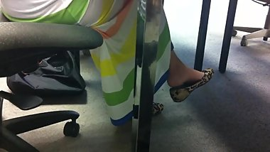 chines girl shoeplay dangling in library