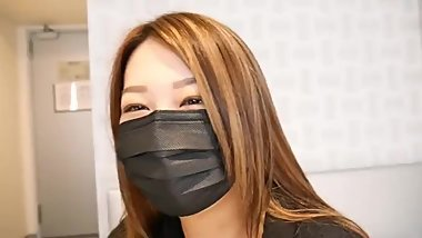 CUTE ASIAN GIRL TRIES ON SOME SURGICAL MASKS