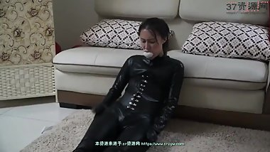 gagged asian spy tries to make phone call