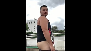 asian chubby bear exhibitionist in Square /While listening to the birdsong