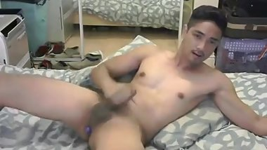 Sexy Asian man sticks an ohmibod in his asshole
