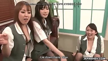 Three Asian schoolgirls attack a muscled jock with their pussies