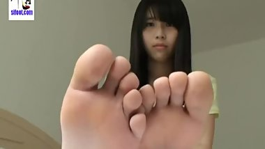 Unhappy Asian Exposing Her Soles